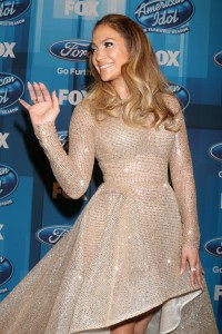 Jennifer Lopez long layer big beach waves. Balayage hair color